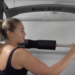 Iskra Lawrence on a Body-Solid Smith Machine