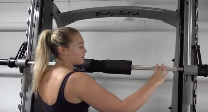 Iskra Lawrence Body-Solid SCB1000 Smith Machine